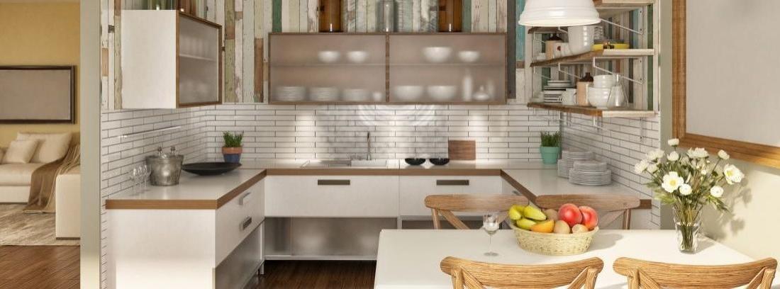 Vista general cocina con mesa grande y muebles blancos