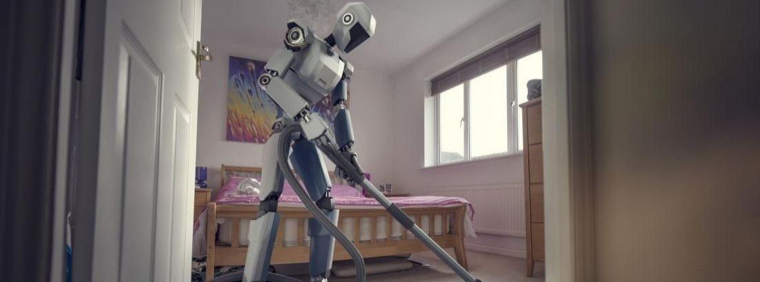 Un robot con un cubo y una fregona y un aspirador