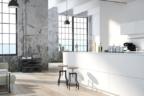 Cocina moderna blanca con isla y sofás