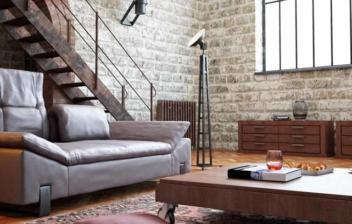 Loft con pared de ladrillo, un gran ventanal y decoración industrial