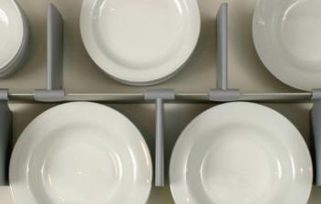 Vista interior de gaveta de cocina con separadores y vajilla blanca.