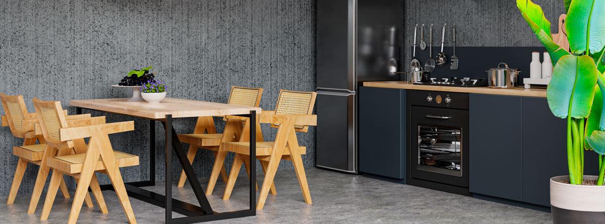 Cocina amueblada con la pared de hormigón